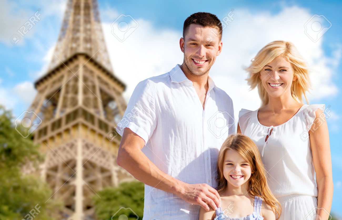 39649465-summer-holidays-travel-tourism-and-people-concept-happy-family-in-paris-over-eiffel-tower-background-Stock-Photo