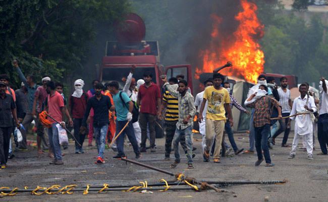 ram-rahim-followers-violence-afp_650x400_51503728027